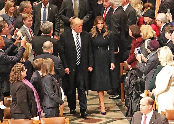 President Donald J. Trump and First Lady Melania Trump enter the Washington National Cathedral during the National Prayer Service, in Washington, D.C., Jan. 21, 2017. More than 5,000 military members from across all branches of the armed forces of the United States, including Reserve and National Guard components, provided ceremonial support and Defense Support of Civil Authorities during the inaugural period. (U.S. Army photo by U.S. Army Sgt. Paige Behringer)